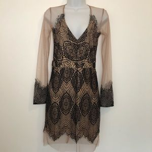 Sheer nude and black lace dress